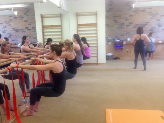 Students work at the barre during a Dailey Barre class.