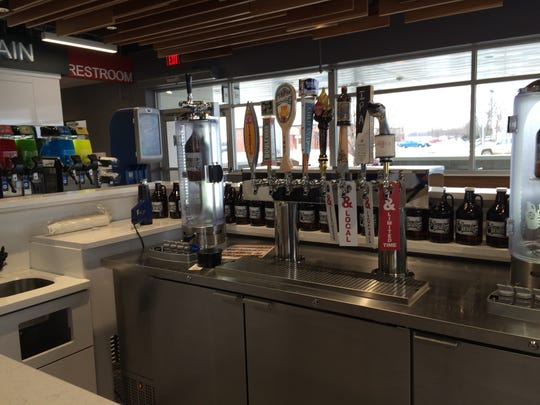 The new Kum & Go convenience store in Johnston offers a growler station with craft beers.