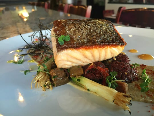 Revery chef Danny Salgado taps Spanish flavors to highlight seared salmon.