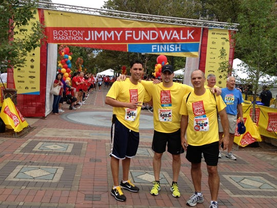Dave Cantin (center) with friends after walking the