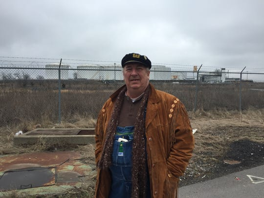 Mark Barrett, vice president of The Nations Neighborhood Association, stands in front of a portion of the site eyed for development.