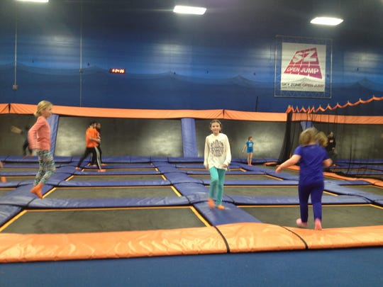 Little girls jump and bounce after school at Sky Zone