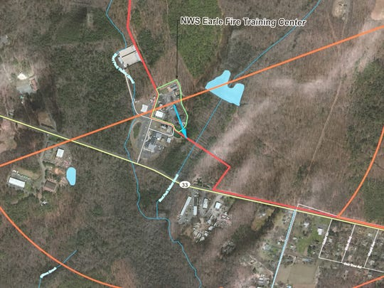 The Naval Weapons Station Earle Fire Training Center where PFCs were found in groundwater. The orange indicates where homes should be tested.