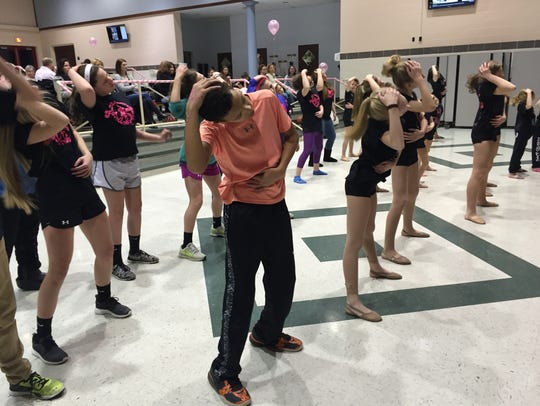 Kids at Hanover Middle School dance to the instructions