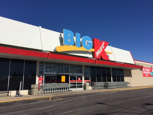 The front door of Kmart on West 12th Street was damaged