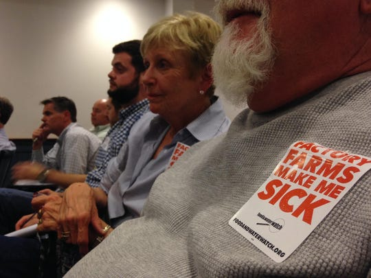 Audience members listen at a Somerset planning and zoning commission meeting about poultry house regulations in 2015.