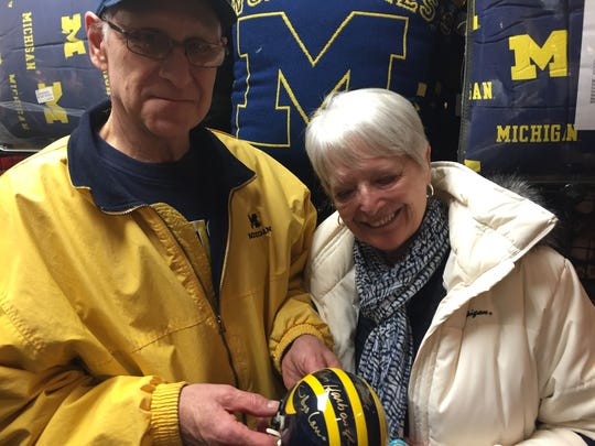 Fans show off signed gear at the M Den in Ann Arbor on Friday, February 19, 2016.