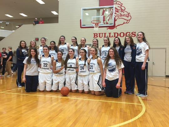 Central Catholic poses for pictures after winning the