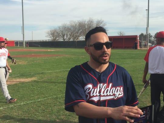 Former Socorro baseball player Omar Quintanilla greets friends after the ceremony Saturday at Socorro High School.
