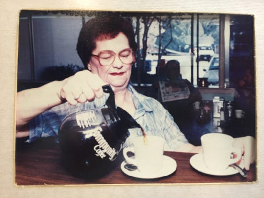 This photo of a server was taken in 1990 in Dywer's Cafe.