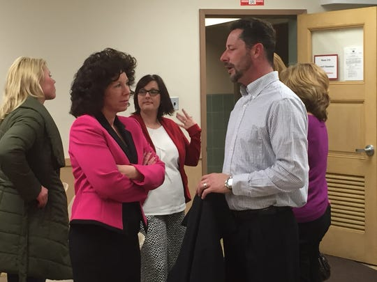 Lebanon Mayor Sherry Capello (left) speaks with Tom Morrissey, owner the Samler Building and several other downtown properties, after Lebanon City Council approved creating a Business Improvement District in downtown Lebanon.