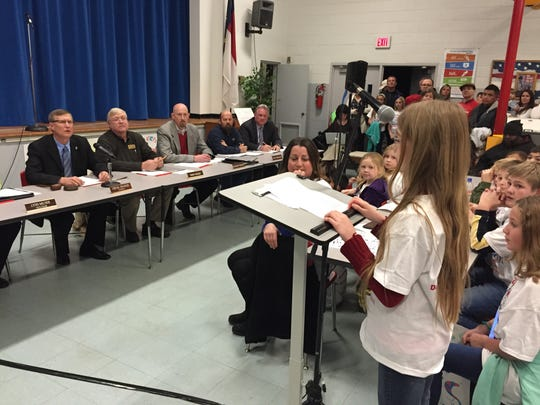 A student speaks to members of the Haywood County school board during a hearing in January regarding Central Elementary. The board voted earlier this month to close the school.