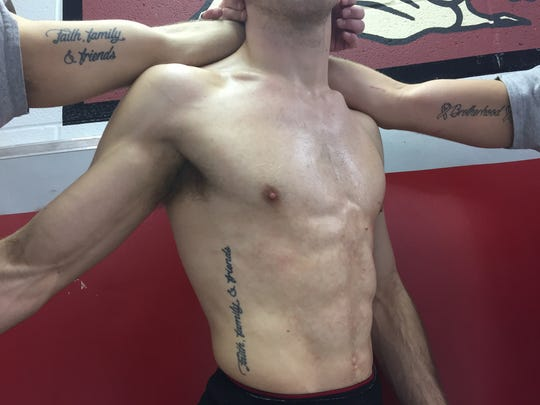The Kieffer brothers show their tattoos.