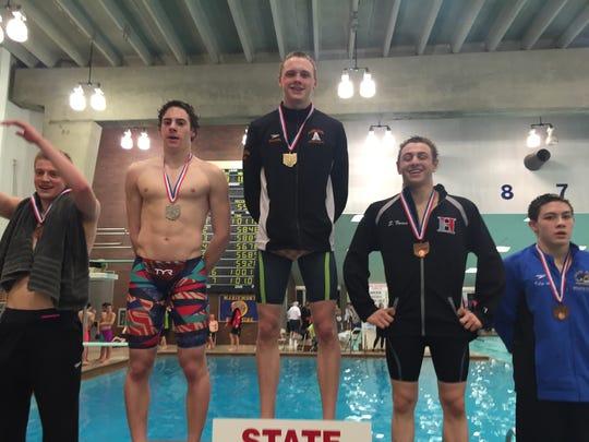 Ashland sophomore Hudson McDaniel stands atop the podium