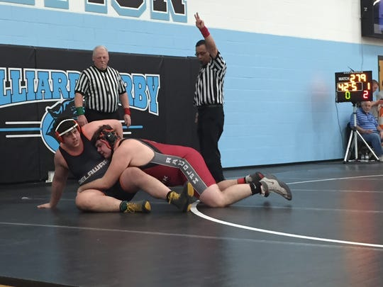 Newark senior Jamye Randolph earns two points Saturday in his heavyweight consolation match against Delaware's Paul Lance during the Division I district tournament at Hilliard Darby.