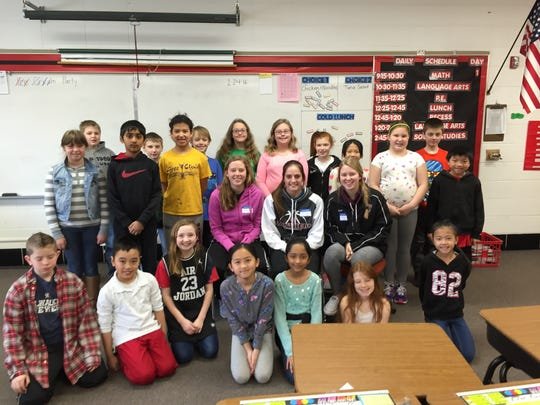 Members of the SPASH Varsity Basketball Team joined elementary classrooms sharing their favorite books for World Read Aloud Day.