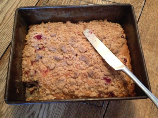 Whole wheat pastry flour, rolled oats and maple syrup make this delicious cranberry coffee cake a bit more healthful than other recipes for cranberry-studded breakfast treats.