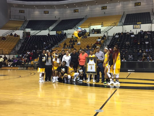 The Grambling women's basketball team honors senior Chanta Poole after Monday's game against Mississippi Valley State.