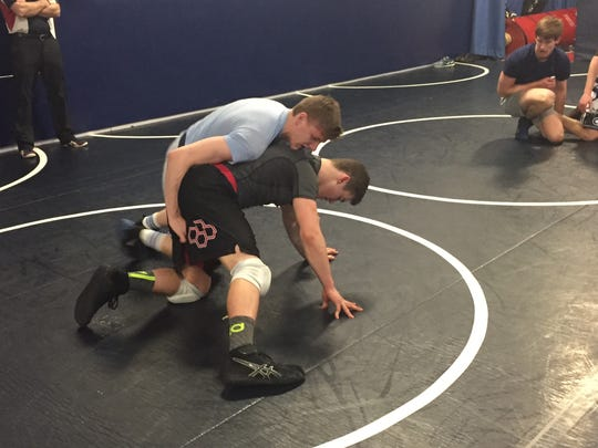 Granville junior Luciano Mendicino, top, drills with freshman Keegan VanMeter during practice Monday. Mendicino is competing in the Division II state tournament this week at 152 pounds.