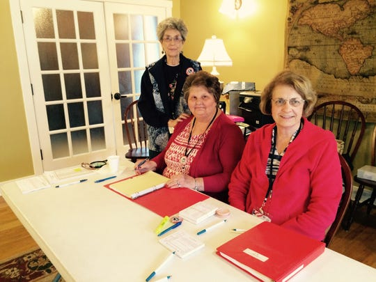 Charlotte precinct voting station at the Collier House on the square, - Glenda Shelton, Ruth Bone and Vivian Wrenn work the table checking in voters.