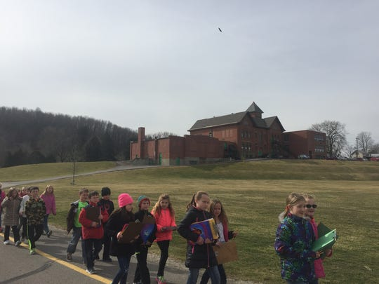 Bellville Elementary students walk from the main building to the lower building, a trek that will not be needed if new schools are built.
