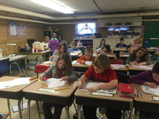 Fourth-graders work on English language arts in a lower-level classroom at the 121-year-old Bellville Elementary School.