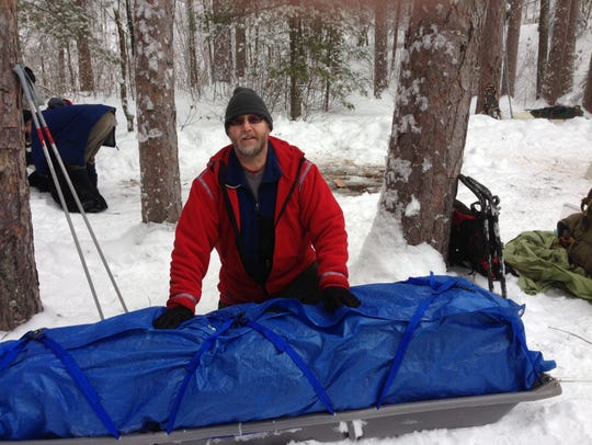 Chuck Rose of Sartell packs up after a weekend camping
