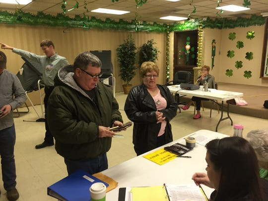 Todd and Malinda Campbell prepare to vote with the