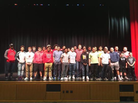 Members of the Laurel High School football team pose