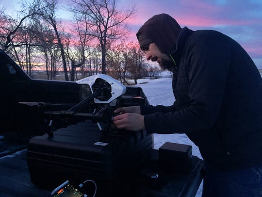 Sean Heavey gets his drone ready to launch.