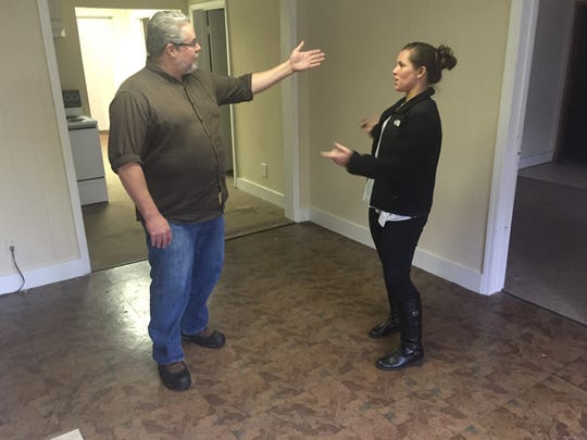 Way of Hope Director Brad Blomgren talks with property manager Kara Kirk at the building where The Way Church will be located, which will house women in The Way of Hope emergency shelter program.