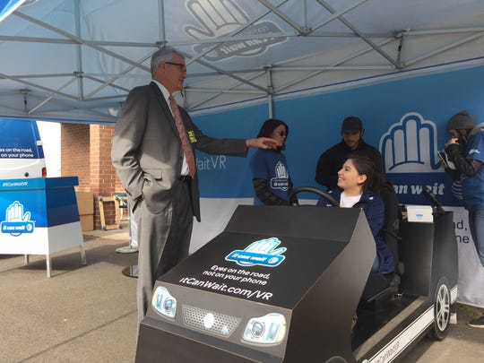 AT&T External Affairs Director Rich Roche, left, talks to Stayton High School Student Nicole Boyer about trying the virtual reality simulator for the first time.