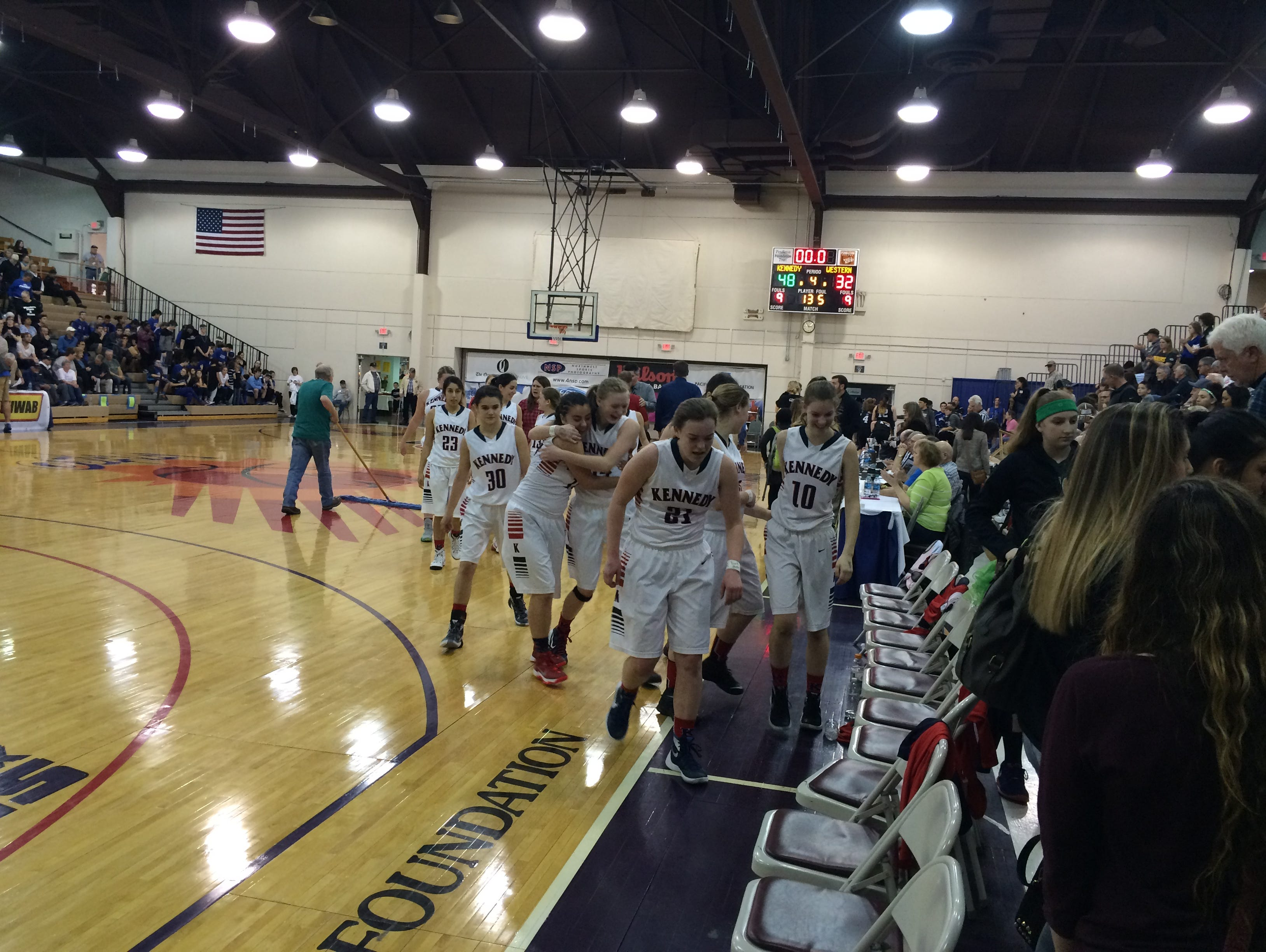 Kennedy's girls basketball team celebrates its state semifinal victory against Western Mennonite on Friday in Pendleton.