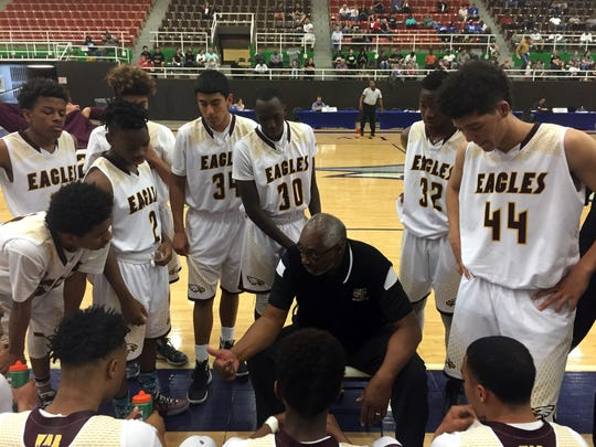 Andress coach Jim Forbes talks to the team during a timeout in the second half of the Class 5A regional semifinal game last season in Snyder.