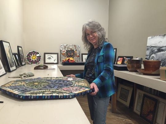 """Artist Denise Moclair stands next to her mosaic, """"Earth Chalice,"""" at The Artisans Loft in Staunton on Saturday, March 5, 2016. Moclair now manages the gallery full time and ready to celebrate the Loft's one year anniversary on Nov. 11 in a holiday show featuring over 400 pieces of art."""