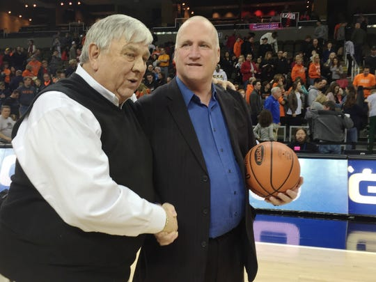 Holmes AD Stan Steidel, head coach Tony Perkins, and the game ball.   Ryle vs. Holmes. 9th Region girls basketball championship game. March 6, 2016. BB&T Arena. Northern Kentucky University. Highland Heights KY.  Holmes 45, Ryle 42. Holmes wins first regional title since 2002.