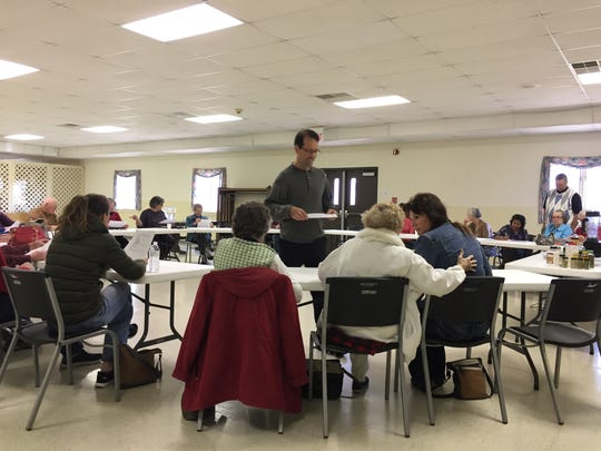 Mark Ehrlich hands out recipes at a healthy, plant-based cooking class at Waynesboro Seventh-Day Adventist Church on Sunday afternoon.