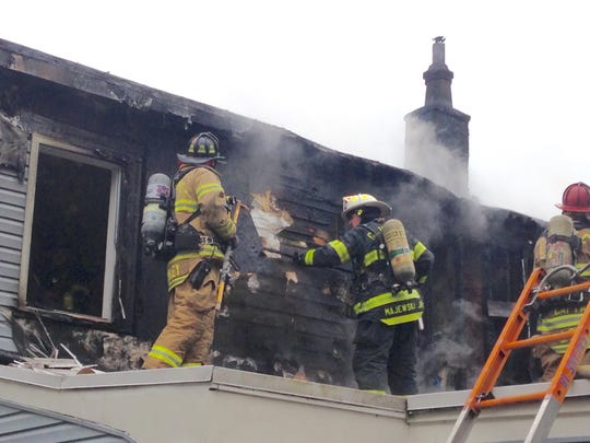 Two families were displaced Sunday after a fire ripped through a home in New Castle.