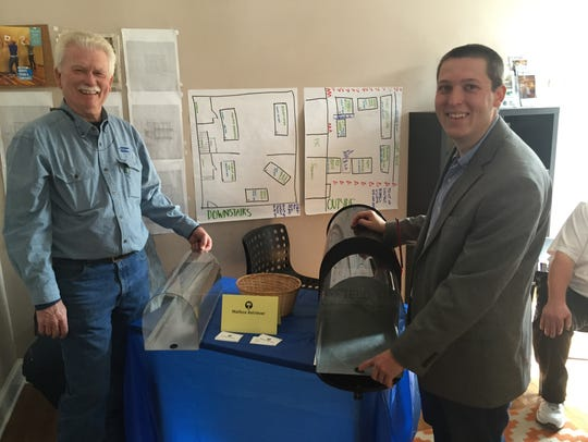 Andrew Hendricks, right, shows his invention, Mailbox