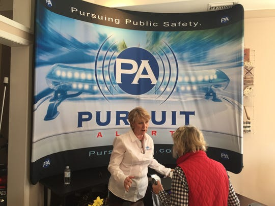 """A representative of Pursuit Alert explains the device invented by former Assistant Sheriff Tim Morgan to alert drivers to high-speed police chases, at the Pickens Innovation Center Commercialization Day """"Launch"""" on Monday."""
