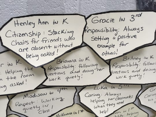 """Students at North River Elementary School can win the """"you rock"""" award and their names are added to a rock wall in the lobby of the school."""