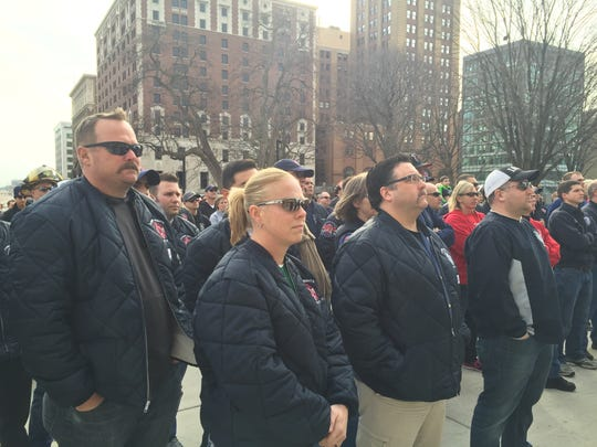 Hundreds of firefighters stand on the Capitol's east lawn the morning of Tuesday, March 8, 2016 and listen to speakers rallying for the Legislature to deposit money in a cancer treatment fund for first responders.