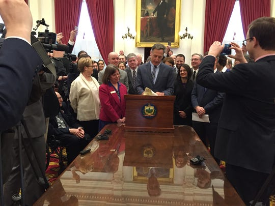 Gov. Peter Shumlin signs Vermont's paid sick days bill in 2015.
