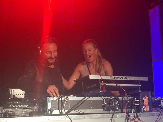 DJ Bob Sinclar and tennis pro Victoria Azarenka share a moment at the Desert Smash concert at Westin Mission Hills.