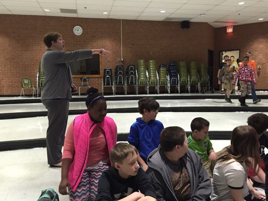 Beverley Manor Middle School principal Sarah Melton directs sixth graders to sit in rows in the forum. Students listened to News Leader education reporter Megan Williams talk about being a reporter.