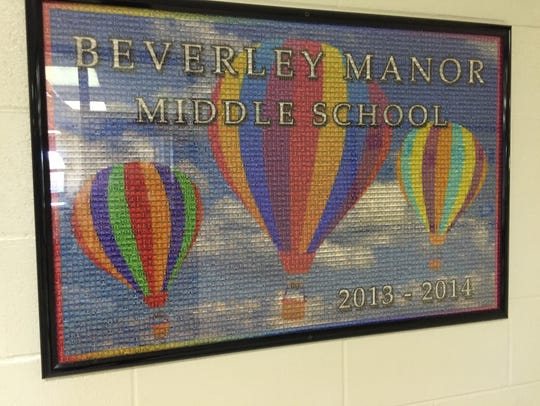 A mural made up of student yearbook photos from 2013-2014