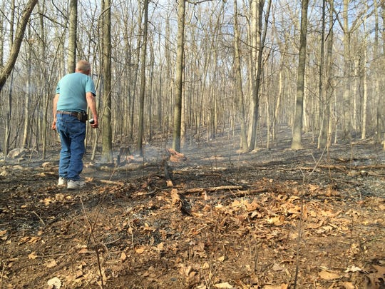 White smoke from a brush fire on Thursday could be seen from miles away. Crews dealt with shifting winds throughout the afternoon.