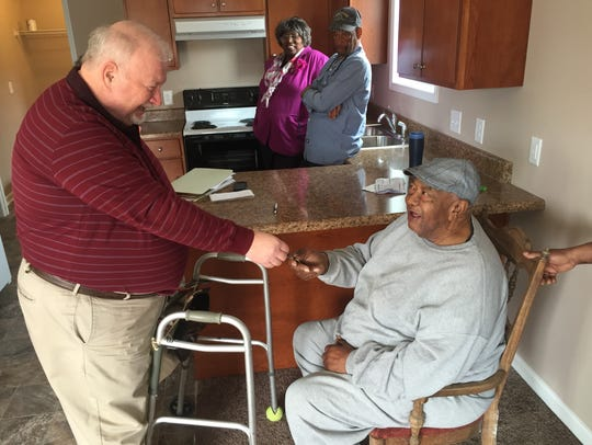 As Murfreesboro's Community Development director, John Callow, left, helped more than 100 families become homeowners.
