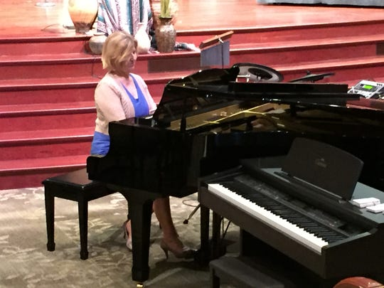 After speaking at First Baptist Church of Simpsonville Friday, State Superintendent of Education Molly Spearman played two songs on the church piano.