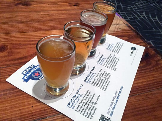 A flight of beers at IndyStar's Malt Madness Final Eight Party at The District Tap in 2015.